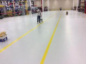 Warehouse floor line striping installation.jpg